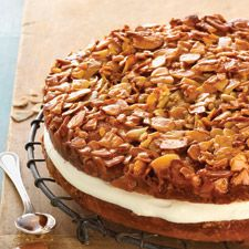 """Bienenstich:(""""bee sting""""), a yeasted pastry dough, German in origin, filled with custard and topped with honey-glazed sliced almonds"""