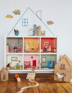 bookcase dollhouse... Buy a shelf with fabric drawers just for the top layer  and put all the dolls in the drawers. The rest you can decorate to make it your own personalized dollhouse!