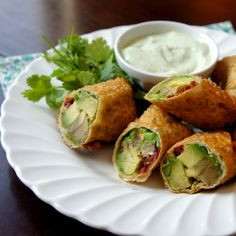 Avocado Egg Rolls with Creamy Cilantro Ranch Dip... link for the recipe:    http://www.iwashyoudry.com/2012/08/31/avocado-egg-rolls-with-creamy-cilantro-ranch-dip/