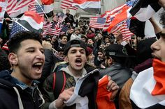 Thousands turn out for rally after Yemeni bodegas shut doors in protest at Trump 'Muslim ban' in New York