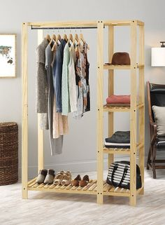 Whitmor's Slat Wood Wardrobe adds additional space to your bedroom or closet while also showcasing the beauty of wood built products. The unit features lacquer finished natural wood with a metal hangi Pallet Wardrobe, Diy Wardrobe, Wardrobe Rack, Open Wardrobe, Pallet Closet, Wardrobe Design, Wardrobe Ideas, Portable Closet, Diy Home Decor