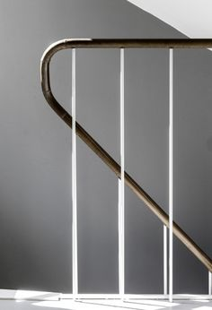 Powder coated steel balusters with leather wrapped handrail