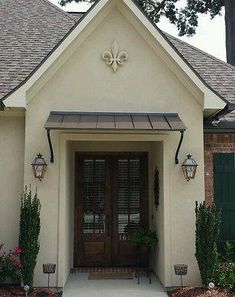 Have a look at this interesting contemporary garage doors - what a clever type Metal Door Awning, Front Door Awning, Front Door Canopy, Door Overhang, Copper Awning, Porch Awning, Patio Roof, House Awnings, Window Awnings