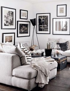 Black and white art, pillows, couch.