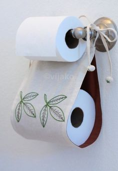 Ah yes, the 'I've run out of TP while sitting on the throne conundrum'. Do we yell for our boo to fetch a replacement roll, or do we maintain our dropped trou and hobble to the TP stash to get our own? I say we don't do either and have a spare nearby nestled in something like Etsy's vijako's toilet paper holder. This particular model sells for $25 bucks.