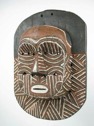 african mask with geometric shapes
