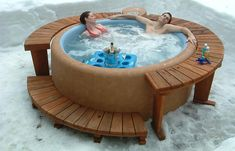 A Couple Sitting In Softub