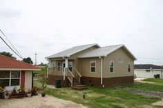Elevated basement Southridge Model with modifications post Katrina. — in New Orleans, LA. #steelhomes #diyhomes #homes