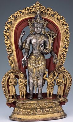 14th century circa, Nepal, Khasa Malla Kingdom, bodhisattva Lokeshvara, parcel gilt silver, parcel gilt copper alloy base and halo, pigments