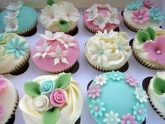 "Pastel floral cupcakes by ""Truly Sweetly Madly Cupcakes"" in Ware, UK."