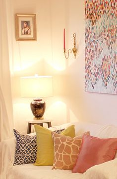pillows, in different colors & prints, plus that to-die-for print on the wall.