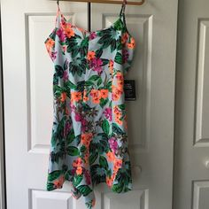 Express Floral Romper  Tropical and floral brand new Express shortie romper! How cute is this for summer?? Adjustable straps. 95% cotton. 5% spandex. No trades Express Other