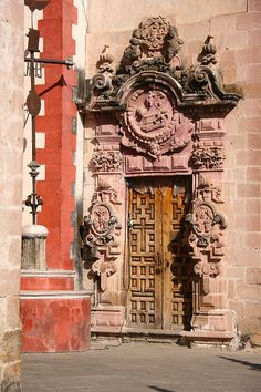 A very elaborate door in Taxco, Mexico. Taxco is a town in the state of Guerrero, southwest of Mexico City, famed for its silver jewelry production and Spanish colonial architecture. Plaza Borda, the main square, is home to the landmark Iglesia de Santa Prisca, an 18th-century rose-colored church in the elaborate churrigueresque style. (V)