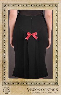 Long kick-pleat pencil skirt