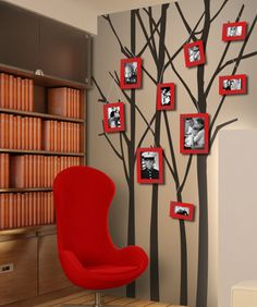 """Bare Trees Vinyl Wall Decal -- I absolutely LOVE how they are """"hanging"""" pictures from the branches. So creative!"""