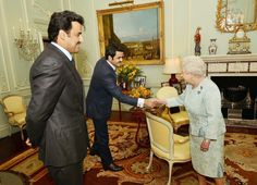 Queen Elizabeth II Photos - LONDON, UNITED KINGDOM, JANUARY 29: Queen Elizabeth II shakes hands with His Excellency Sheikh Joaan bin Hamad Al-Thani, the younger brother of the Emir of Qatar, Sheikh Tamim bin Hamad Al Thani (left), during a private audience at Buckingham Palace on January 29, 2014 in London, England. - Weekly Bucket