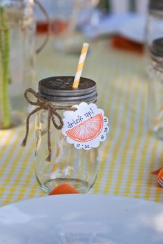 I made wedding favors from mason jars with daisy lids, vintage stripey paper straws and handstamped tags.