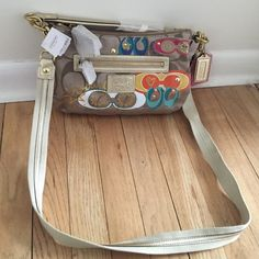 Coach Purse Mulitcolored small/medium size This Coach purse is in mint condition with tags. Authentic, never been worn. Coach Bags Crossbody Bags