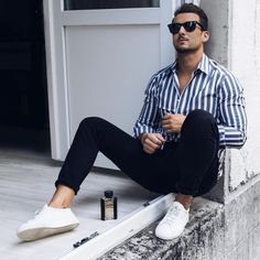 - with a summer business casual outfit idea with a blue striped shirt black denim no show socks sunglasses white leather sneakers Stylish Men, Men Casual, Casual Styles, Outfits With Striped Shirts, Stripe Shirts, Summer Business Casual Outfits, Summer Outfits Men, Men Summer, Vertical Striped Shirt