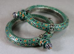 A pair of silver and enamel bracelets from Sindh, Pakistan. Very similar to Multan bracelets but with an unusual mint green color on the bracelets.