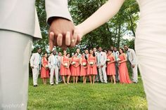 Love this photo of the bridal party and the bride and groom!    ...cute photo of bridal party under bride & groom's hands
