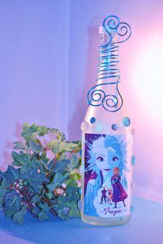Frozen Elsa and Anna Bottle Light Disney Movie Lamp Olaf Ice Snowman Let it Go Turquoise Lamp Frost Ice Blue Ariel Tinkerbell wine bottle by GypsyBottleBoutique on Etsy https://www.etsy.com/listing/202427509/frozen-elsa-and-anna-bottle-light-disney