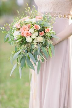 Pink and ivory rose bouquet with greenery. #bouquet #rosebouquet #weddingchicks Florals By: Chelish Moore Flowers ---> http://www.weddingchicks.com/2014/04/25/table-for-two-romantic-engagement/