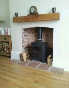 Floor level opening...big base trim...nice bricks and pavers.  wood stoves with mantle - Google Search
