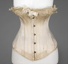 Gorgeous... 1881-1882, French, silk, masses of bones. Really like the doubled up lace at top, inspiring.
