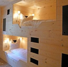 Perhaps convert plywood enclosure in office to bunk guest beds like this.