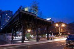 Traffic passes the southern terminus of the High Line, at the intersection of Gansevoort and Washington Streets. Photo by Marcin Wichary.