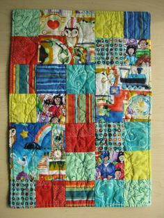 Baby steps in machine quilting -- Scared to try free-motion quilting? Make practicing more fun when you try FMQ on doll quilts!