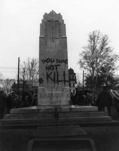 "https://flic.kr/p/qTvewT | Desecration of the Cenotaph, Port Arthur | Date: 11 November 1969  Description: Photograph of the cenotaph in Waverley Park (Port Arthur, ON) after it was vandalized. The words ""Thou Shalt Not Kill"" have been spray painted on the surface of the war memorial. The Remembrance Day ceremony went forward as planned.   Photo from the Chronicle-Journal collection.  Accession No.: 990.56.1522"
