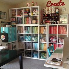 A nice sewing room area. I like the matching baskets with scraps in them.