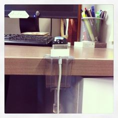 The Charger Clip. Great for the desk at work...http://cablecatcha.com