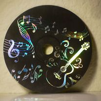 Scratchboard CD A great way to recycle old cd's. Paint them with black (or any dark colored) acrylic paint, let dry, then use a sharp object to scratch a picture into it.