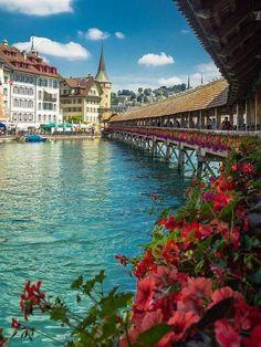 Switzerland - Lucerne's famous wooden Chapel Bridge (Kapellbrücke), a 204 m (669 ft) long wooden covered bridge originally built in 1333.