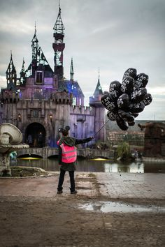"""Banksy has described his Dismaland installation as """"a family theme park unsuitable for children."""""""
