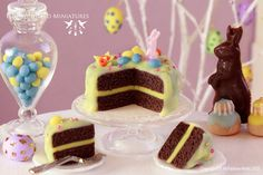 It's a little Easter cake with chocolate sponge, yellow frosting and decorated with tiny daffodil flowers, candy eggs, sprinkles and a pink candy bunny.