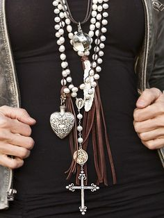 Layers of long necklaces! Loving the charma