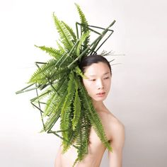 Japanese artist Takaya adorns the heads of models with raw vegetables and blossoming flowers.