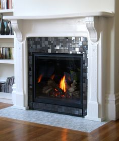 Updated fireplace. Grey & black glass tile. #decor #tile ...