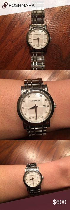 Burberry Authentic Diamond Face Watch Authentic Burberry stainless steel check dial watch with diamond markers with its box. No scratches. Has all original links Burberry Accessories Watches