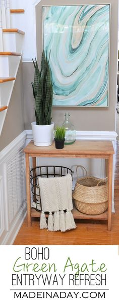 Fresh Entryway Makeover Using Silk Plants,Boho green entryway refresh with baskets, green agate high gloss wall art & a snake plant. #ad via @madeinaday