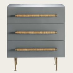 Chest with three drawers, wicker handles, brass trim and legs