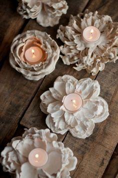Dip dollar store flowers in plaster to make these beautiful floral votives.