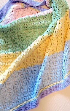 Free Knitting Pattern for 4 Row Repeat Gentle Baby Blanket - Lace baby blanket knit in 6 stitch 4 row repeat. Increases and decreases are done in alternating odd rows so stitch numbers will not be the same in every row. Even rows are purl. Pattern adds the garter stitch border after knitting the blanket, but I think you could experiment with knitting it with the blanket, though I think would make the borders will be wavy because of the lace. Bulky weight yarn. Designed by Lizabeth Towers