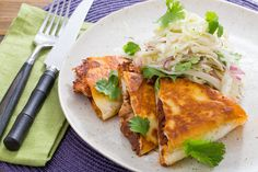 Pulled Chicken Mole Quesadillas with Monterey Jack Cheese & Shredded Cabbage Salad . Visit https://www.blueapron.com/ to receive the ingredients.