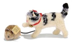 A STEIFF POM-POM CAT AND MOUSE:, standing Cat, (3507), white, black and grey, green and black glass eyes, felt ears, red ribbon with bell and FF button, <I>1936-38 --3in. (7.5cm.) long</I>; and Mouse, (2504), brown, rubber tail and FF button with cream paper tag, <I>1933-36 -1½in. (4cm.) long</I>