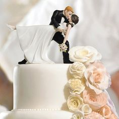 This darling couple is wrapped in the romantic embrace of dance. The Bride's pretty pony tail, simple dress, and rhinestone shoes give this romantic cake topper a lovely modernized twist on a classic